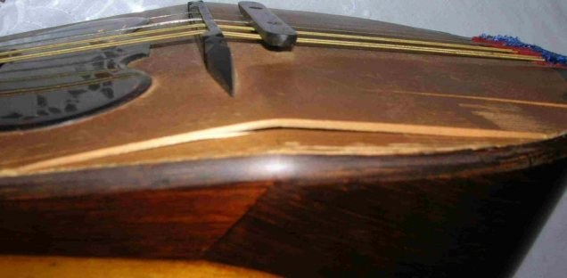 Neapolitan Mandolin Before Restoration, a nasty split