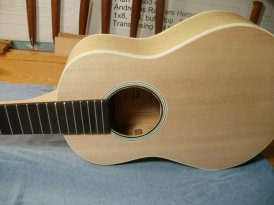 Soundhole showing cedar side brace and solid lining